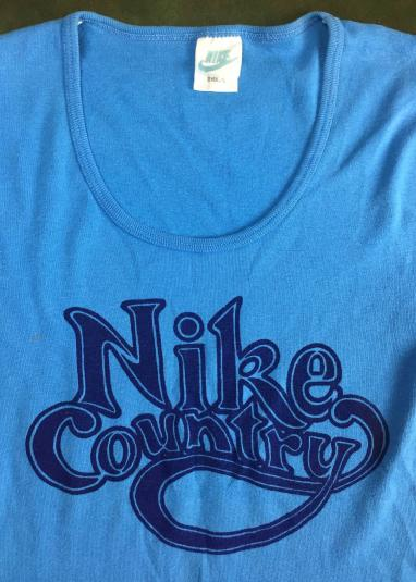 """Vintage 80s Women's """"Nike Country"""" Graphic Blue T-Shirt"""